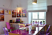 Modern dining room with office area and purple accents