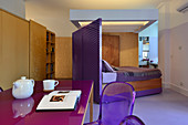 Modern studio apartment with purple accents