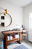 Old wooden workbench used as washstand