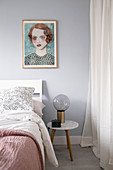 Portrait of woman above bed in feminine bedroom