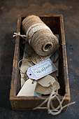 Paper and twine gift tags in wooden box