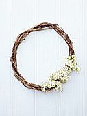 Wicker wreath decorated with spring flowers