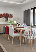 Dining table and chairs upholstered in grey and red