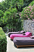 Loungers with pink and purple mattresses on Mediterranean terrace