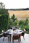 Set table on terrace with view of woods and fields
