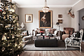 Christmas tree in elegant living room in earthy shades
