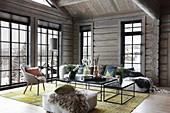 Modern living room in log cabin with lattice windows