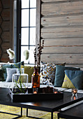 Wintry accessories on coffee table in log cabin
