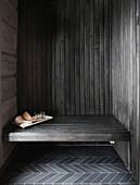 Sauna utensils on bench in niche in log cabin
