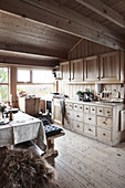 Vintage chest of drawers in open-plan kitchen-dining room in chalet
