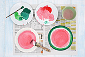 Instructions for painting paper plates with watermelon motif