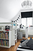 Bookcase against bunk beds in child's bedroom