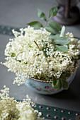 Freshly cut elderflowers in a bowl