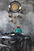 Arrangement of mystical, ethnic accessories in grey and black