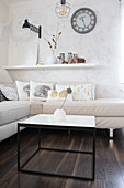 White modern living room with subtle autumn decorations