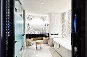 Elegant washstand and patterned walls in luxurious bathroom