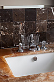 Brown gemstone surface and dark marble tiles