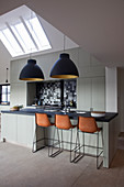 Luxurious, industrial-style kitchen-dining room with gable roof