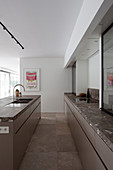 Marble worksurfaces in elegant kitchen with island counter