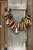 Garland of fir cones on rustic wooden shutter