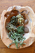 Bowl of dried leaves for making homemade herbal tea