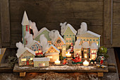 Illuminated Christmas village of pastel cardboard houses