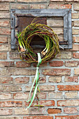 Wreath of twigs decorated with forced bulbs