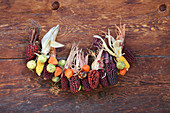 Garland of multicoloured corncobs, chestnuts and physalis