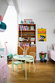 Lime-green table and chairs in vintage-style child's bedroom