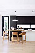 Bar stools at the breakfast bar in a modern kitchen