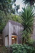 Modern wooden house in tropical garden
