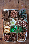 Decorative natural materials, hazelnut biscuits and Christmas decorations in box