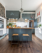 Modern country-house kitchen in slate-grey and white with wooden floor