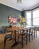 Vintage-style dining room in period interior with grey walls and bay window
