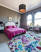 Feminine bedroom with grey walls and arched windows