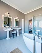 Vintage, twin, pedestal sinks in large bathroom
