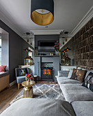Narrow, English-style living room in shades of grey