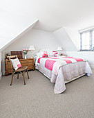 Classic furnishings in bright attic bedroom