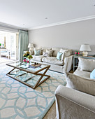 Elegant living room in shades of grey with pale blue accents