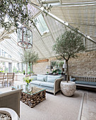 Large, elegant interior with glass roof and conservatory