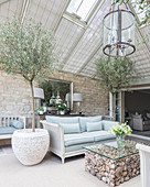 Olive trees in Mediterranean living room with glass roof