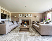 Two sofas facing one another in elegant grey living room