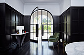 Elegant entrance hall with glass door, cassette cover and dark wooden floor