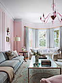Elegant living room with bay window in shades of pink and gray