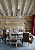 Brown upholstered chairs around table in dining room of chalet