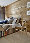 Tartan box-spring bed in chalet