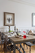 Rustic dining table and metal chairs in dining area
