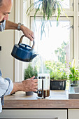 Man pouring water into a cafetiere