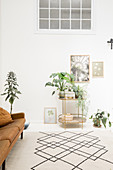 Houseplants on vintage-style plant stand
