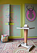 Hat on valet stand in front of fitted wardrobes with birdcage motif